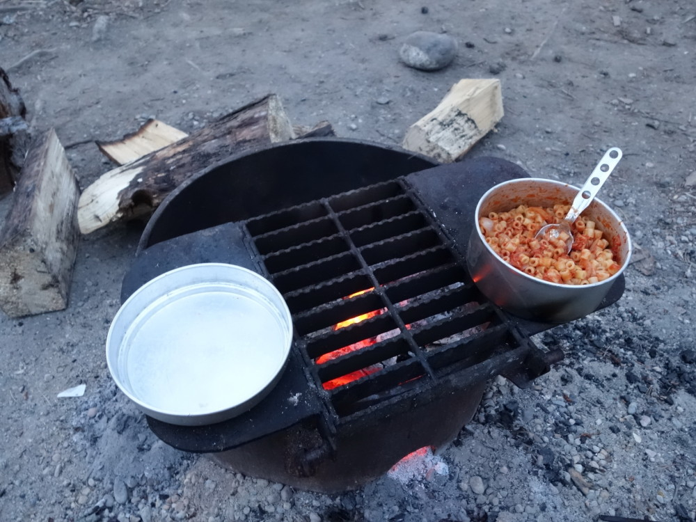 Pasta with tuna red sauce made in wood fire.